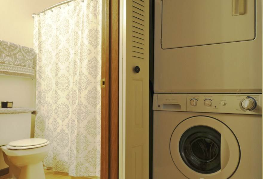 Bathroom closet with washer and dryer