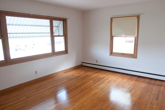 Hardwood floor room with large window