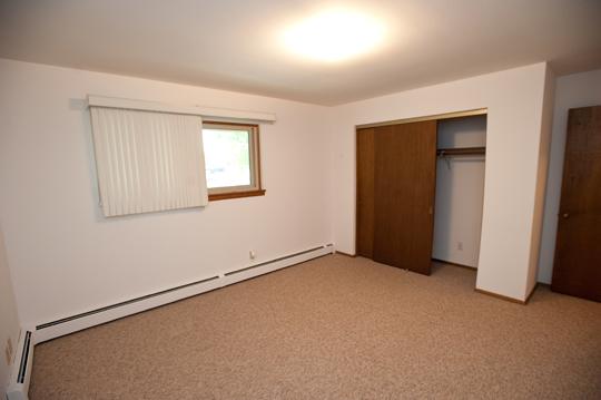 Bedroom with sliding closet door